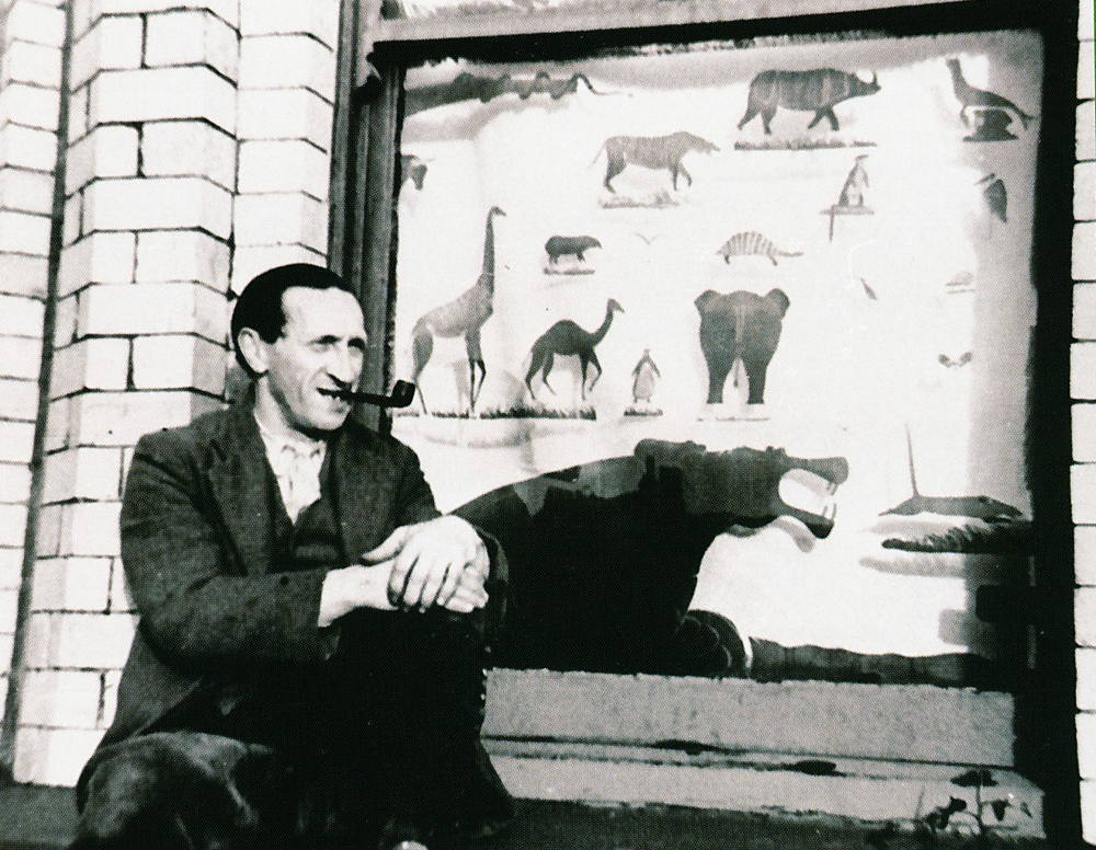 "Mr Neunzer, known as ""Blick"" with his Animal Window, In Hutchinson Square Camp, Douglas, Isle of Man, c.1940."